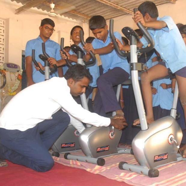 Photo of Gangadhar Prasad with specially-abled students